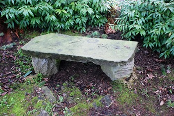 Resting stone seat in garden for relaxing