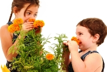 Kids gardening activities - children smelling flowers