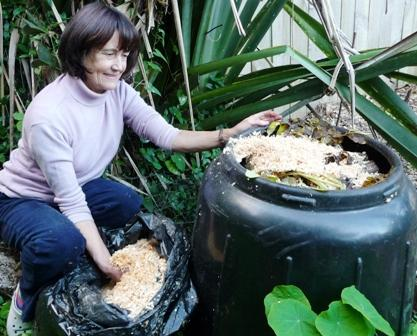 Adding sawdust to compost