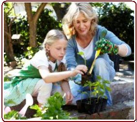 Kids earning about nature - Mother and daughter in garden