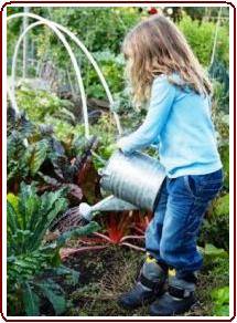 Kids garden crafts - girl watering vegetables