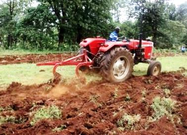 tractor tilling the soil