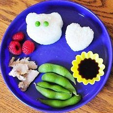 Kids eating vegetables - blue plate of snacks