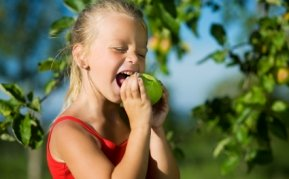 Grow your own fruit, girl eating apple