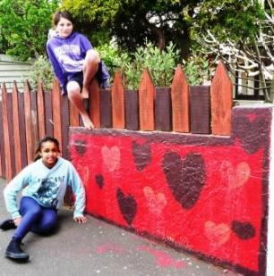 Kids garden crafts - zeni and jasmine's painted garden wall