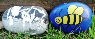 Kids Making things outside - painted stones in garden