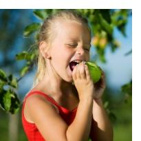 Growing fruit girl eating apple