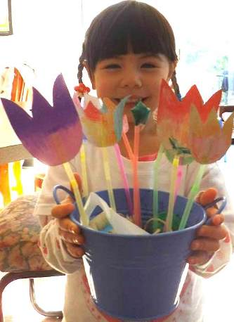 Jessie smiling with paper tulips
