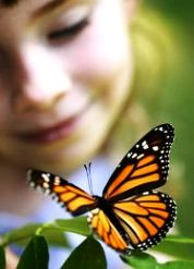 Monarch butterfly and childs face